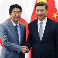 Japanese PM meets with China's Xi in Beijing