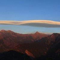 Photo of the Day: UFO-shaped cloud hovers over Taiwan's tallest peak