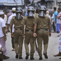 Militants set off bombs during Sri Lanka raid, killing 15