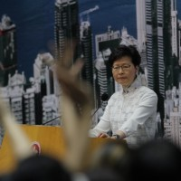 Hong Kong leader fights for political life after bill fiasco