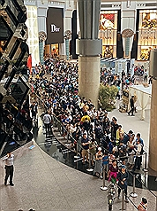 Visitors on the 4th floor of Taipei 101 waiting for the elevator to the observation deck (photo courtesy of Taipei 101).