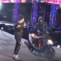 Scooterist barges onto stage during New Year's Eve show in Taiwan