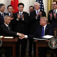 Trump signs 'phase one' of trade deal with Communist China