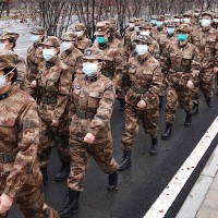 Membersof a military medical team head for Wuhan Jinyintan Hospital.