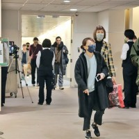 Passengers wearing face masks at a Taiwanese airport.
