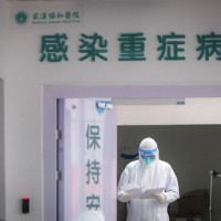 A medical staff member wearing protective a suit works in the department of infectious diseases at Wuhan Union Hospital.