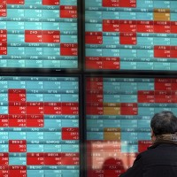 Asian stock markets retreat after surge on China tariff cut