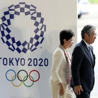 Japanese government insists on holding 2020 Olympics despite surge in virus cases