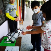 Taiwanese students fight Wuhan virus with robotic Lego alcohol sprayer