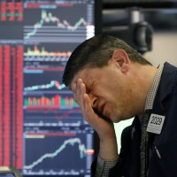 Dow tumbles into bear market as coronavirus fears intensify