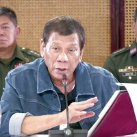 Philippine president suspends domestic travel to and from Manila area for a month