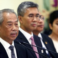 Malaysia closes borders, shuts most businesses in lockdown