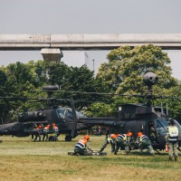 Apache and Kiowa helicopters land at Taipei university campus