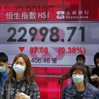 Asian stocks mixed as economic toll of virus worsens