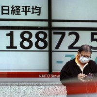 Asian shares mostly lower on worries about pandemic damage