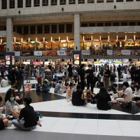 Demonstrators stage sit-in against proposed ban on gatherings in Taipei Main Station lobby