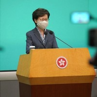 Hong Kong leader says all should learn from year of protest