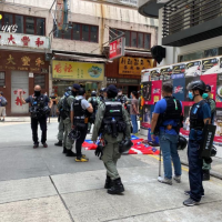 Hong Kong protester arrested with 30 Taiwanese flags
