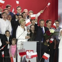 Conservative Polish president wins 2nd term after tight race