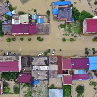 China floods affect 54.8 million people, inflict US$20 billion in losses