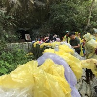 Entrance to Taiwan's Water Curtain Cave littered with tourists' raincoats