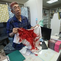 Three charged for attack on Hong Kong bookseller