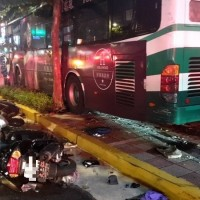 Bus with driver asleep at wheel careens onto Taipei sidewalk, killing scooter driver