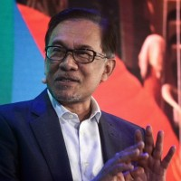 Malaysia opposition leader Anwar claims 'formidable' majority to form new government