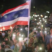 Thailand girds for renewed protests as it marks anniversary of beloved king's death