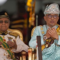 Malaysia's king urges politicians to end uncertainty amid power struggle