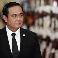 Thai opposition tells PM to stop using monarchy