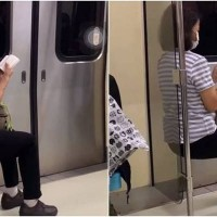 Photo of the Day: Auntie sitting on air chair on Taipei MRT