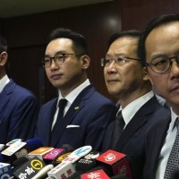 Hong Kong's pro-democracy lawmakers to resign en masse