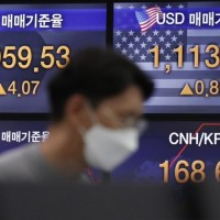 Global shares drop on worries over surging virus cases