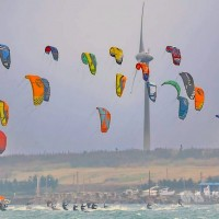 Scores of kitesurfing contestants skim over Penghu waves in high winds