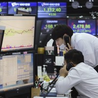 Asia stocks edge higher after vaccine hopes push Wall Street to record highs