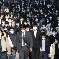 Tokyo daily coronavirus cases hit record 570