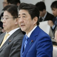 Japan prosecutors seek to query former PM Abe in political funding case - media