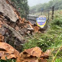 Taiwan train almost buried by rain-triggered landslide