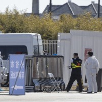 Beijing imposes 14-day quarantine on international arrivals