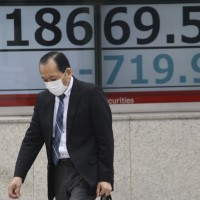 Asian shares extend losses as toll from pandemic surges