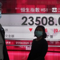 Asian shares skid on virus worries, bleak BOJ survey