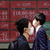 Asian shares mixed after Wall Street rally; Hong Kong lower