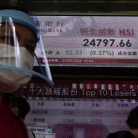 Gold surges, Asian stocks mixed amid US-China feud, pandemic