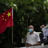 Hong Kong, Chinese officials jeer at US sanctions