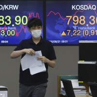Asian shares track Wall Street gains amid vaccine hopes