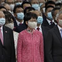 Hong Kong leader delays policy address until Beijing visit