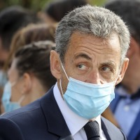 A Paris court has convicted French former President Nicolas Sarkozy of corruption and sentenced him to 1 year in prison.