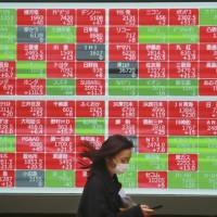 Asian shares mixed on growing hopes for stimulus, vaccines