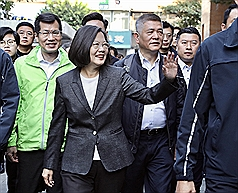 Taiwan's President Tsai urges voters to buttress democracy by casting ballots
